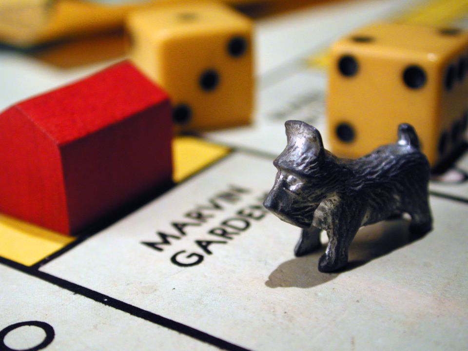 Close up of monopoly game pieces