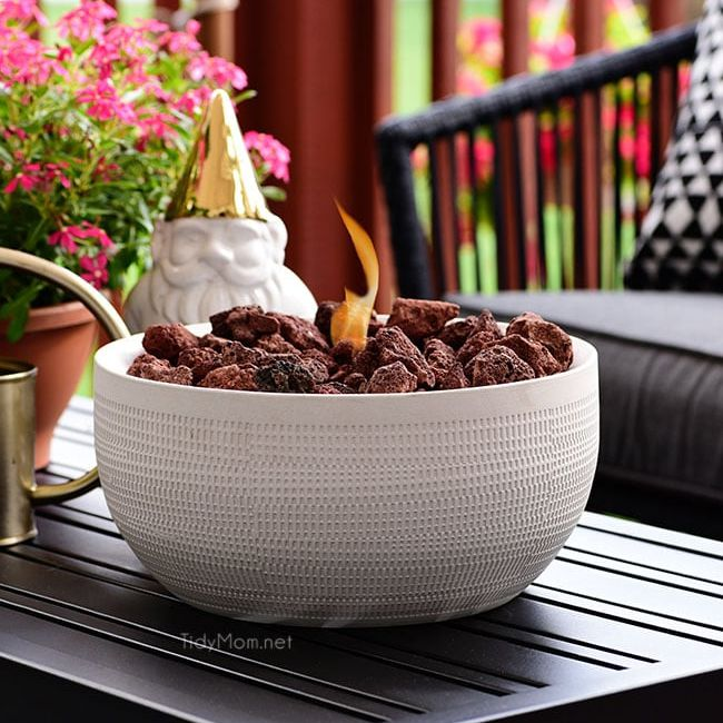 A table top fire bowl on a patio