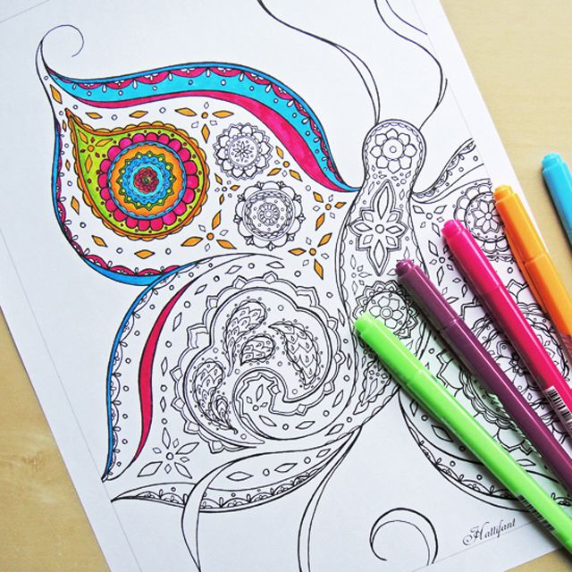 A butterfly coloring page for an adult, partially colored in.