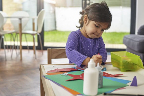 Girl crafting animals on children's table