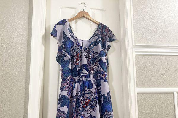 A dress hanging on a door