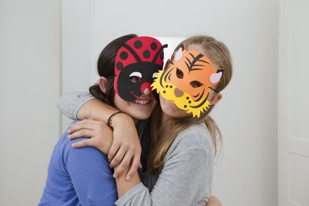 smiling girls wearing colorful masks