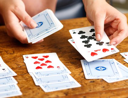 Hands Playing Solitaire Card Game