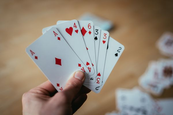 Playing cards: Poker cards in the hand of a young man