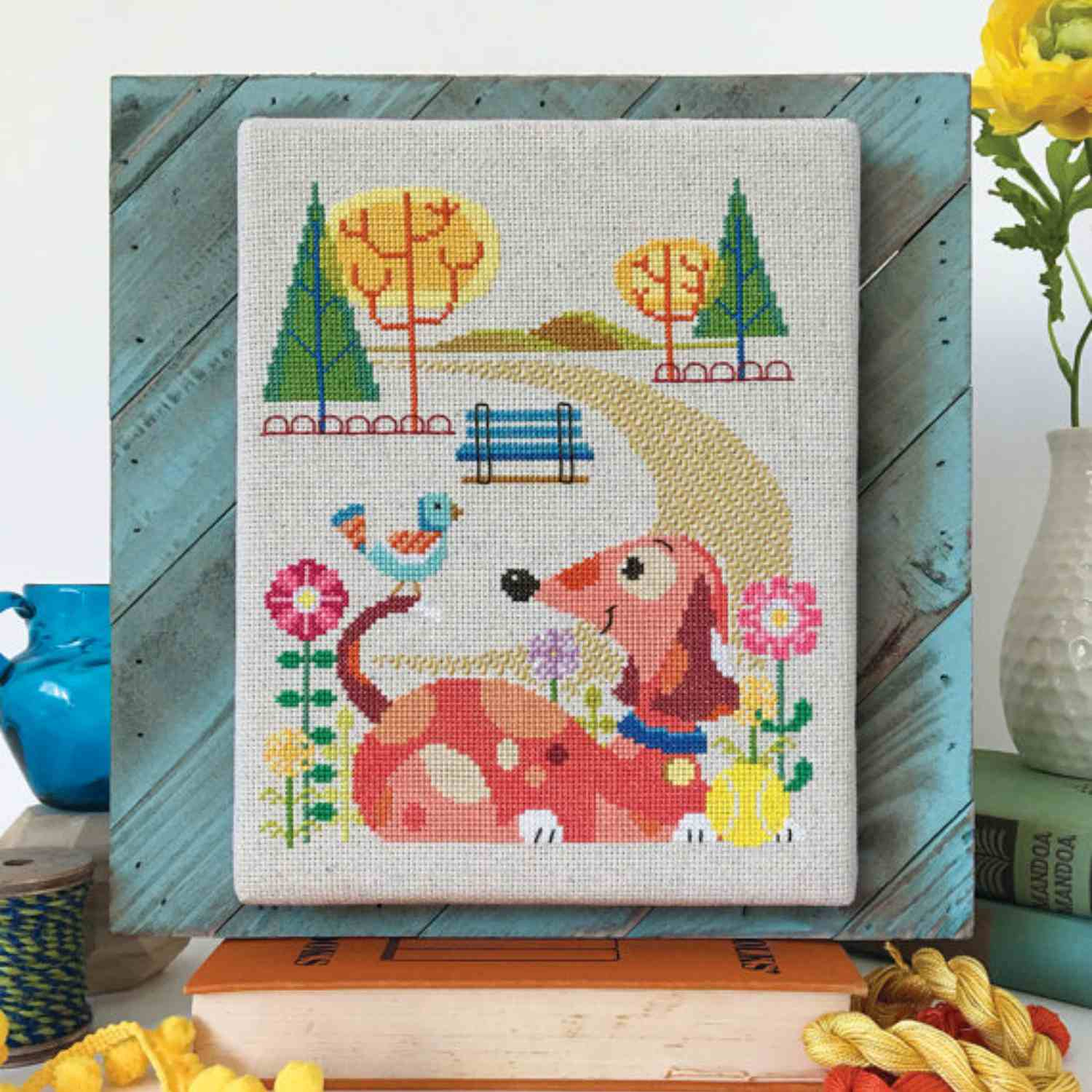 Cross-stitch dog and bird