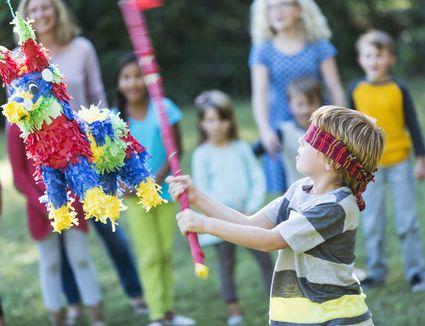 Boy hitting a pinata at a party