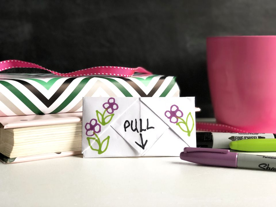 pull tab note with books and markers