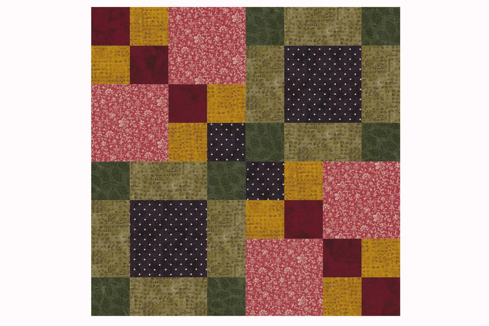 A four square patchwork quilt block pattern