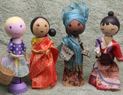 Clothespeg dolls in saree, kimono, gele, bubo and iro, and contemporary dress.
