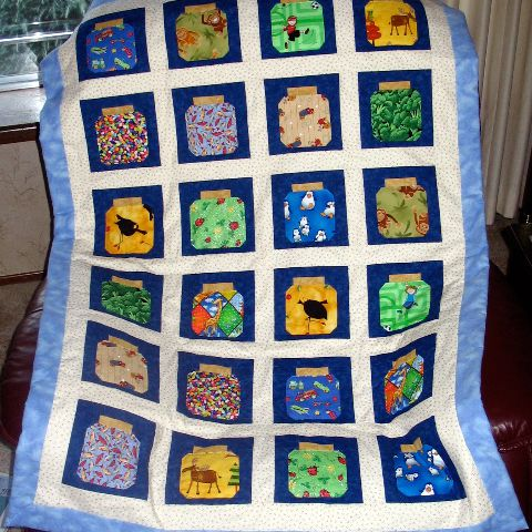Quilt with squares of bug jars.