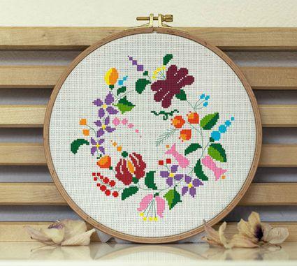 Colorful cross-stitch flower wreath