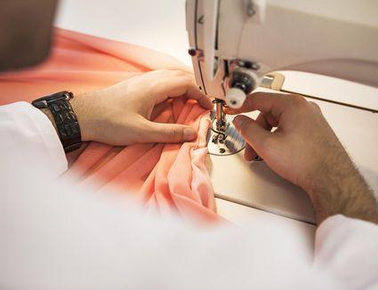 Dressmaker using sewing machine