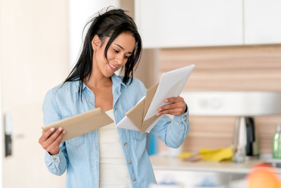 Woman at home checking her mail