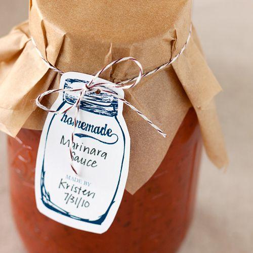 A jar of marinara sauce with a canning tag
