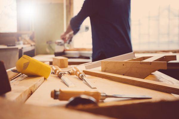 Woodworker using skew chisel