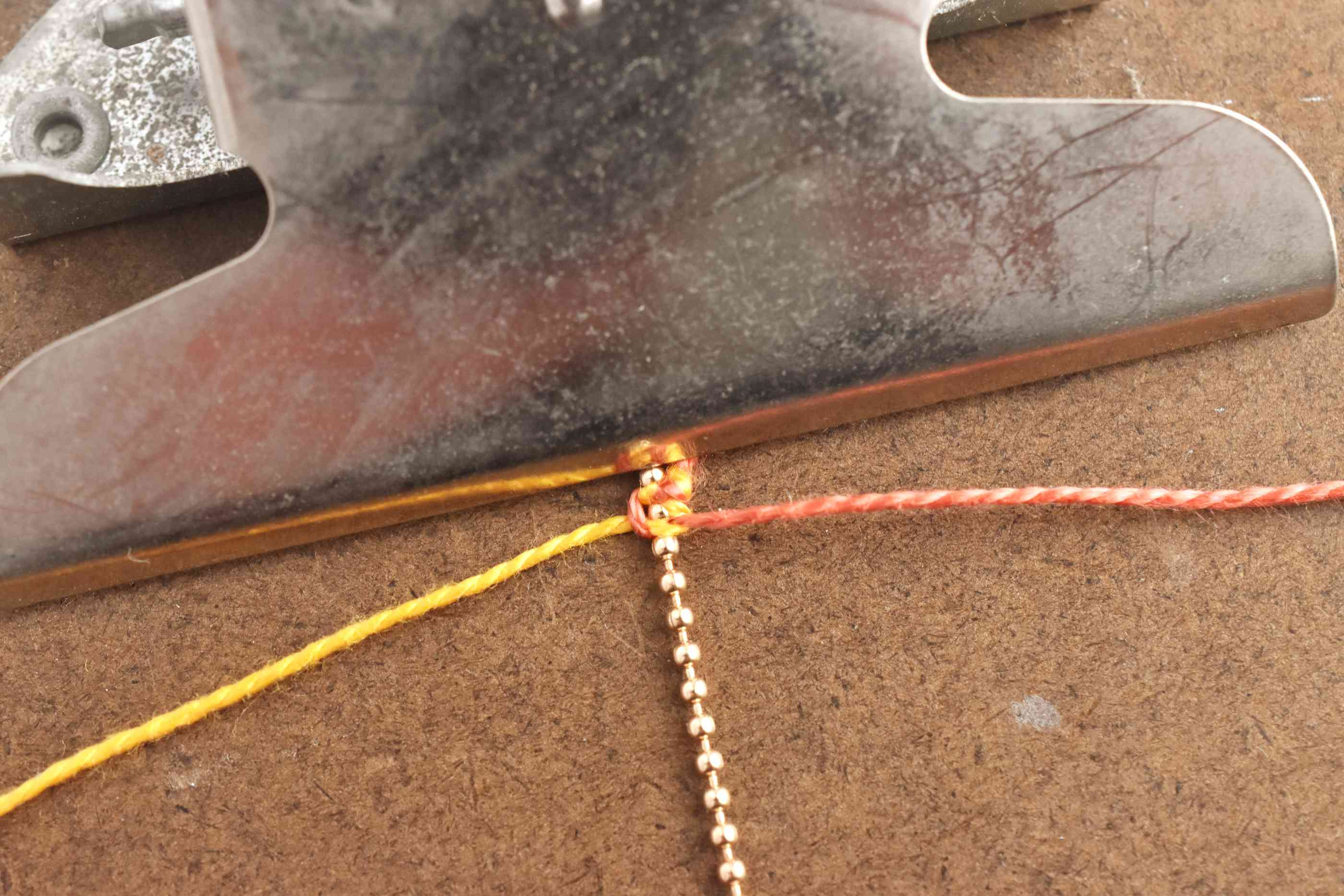 Pull the Knot Tight Around the Chain