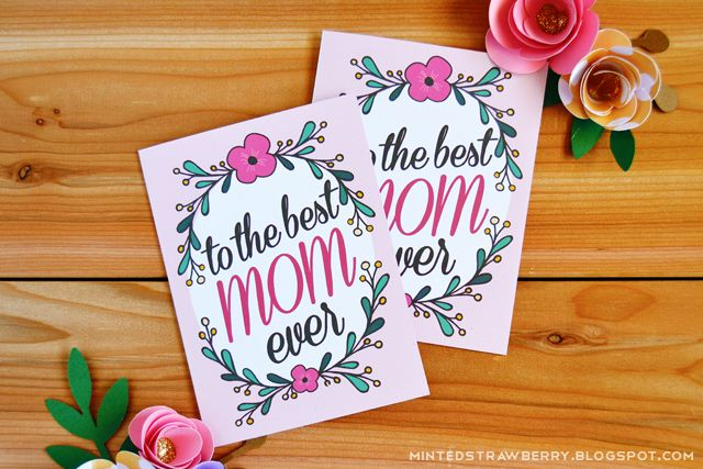 "Two cards on a table that say ""to the best mom ever"""