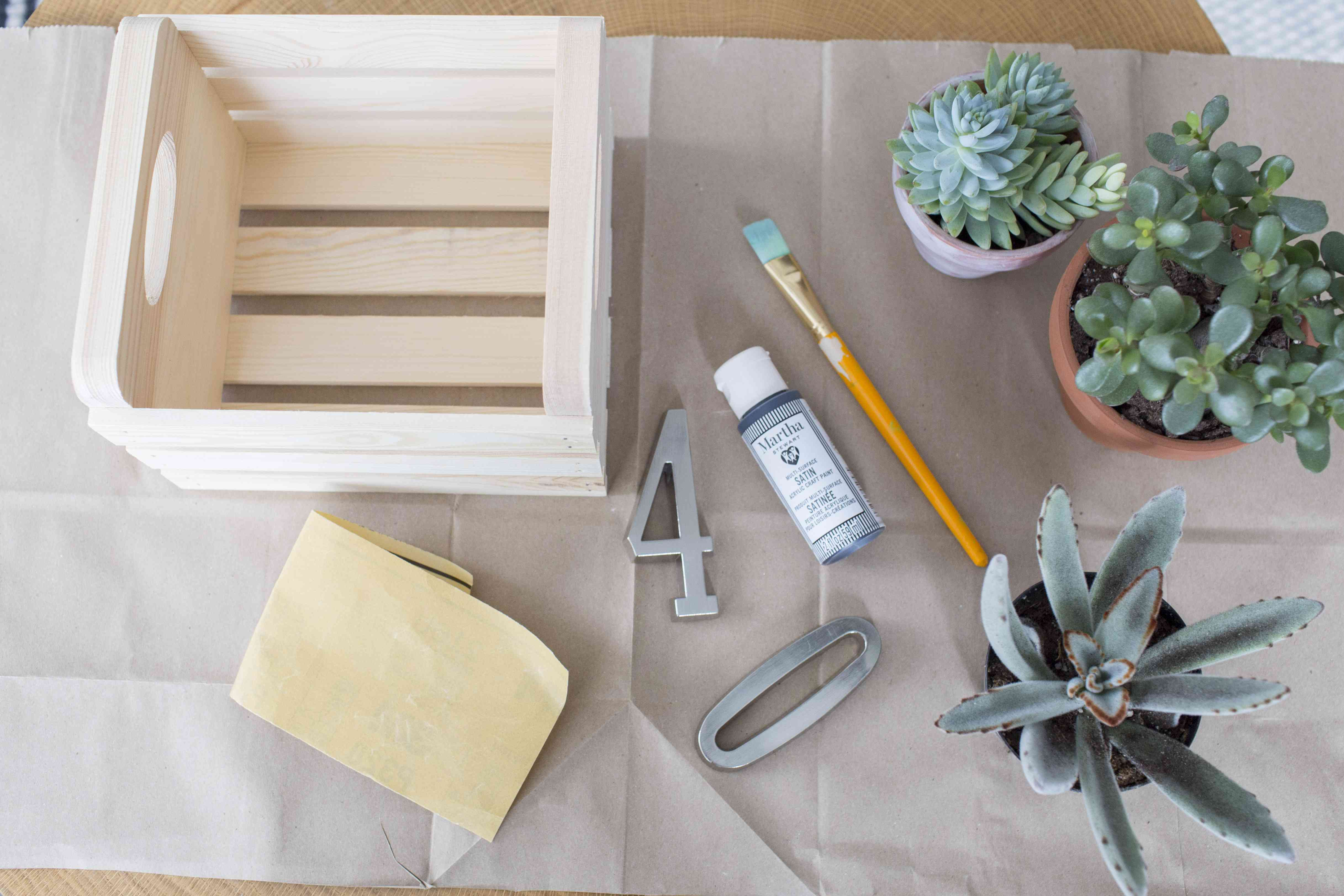 A picture of supplies needed to create a succulent planter house number box