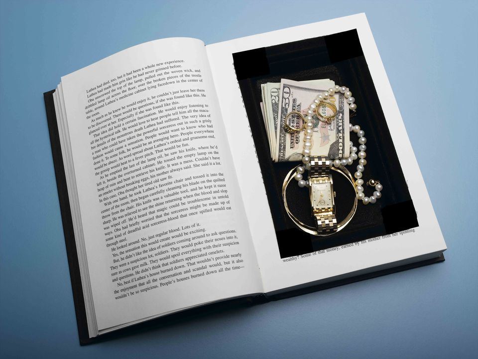a book safe filled with cash and jewelry