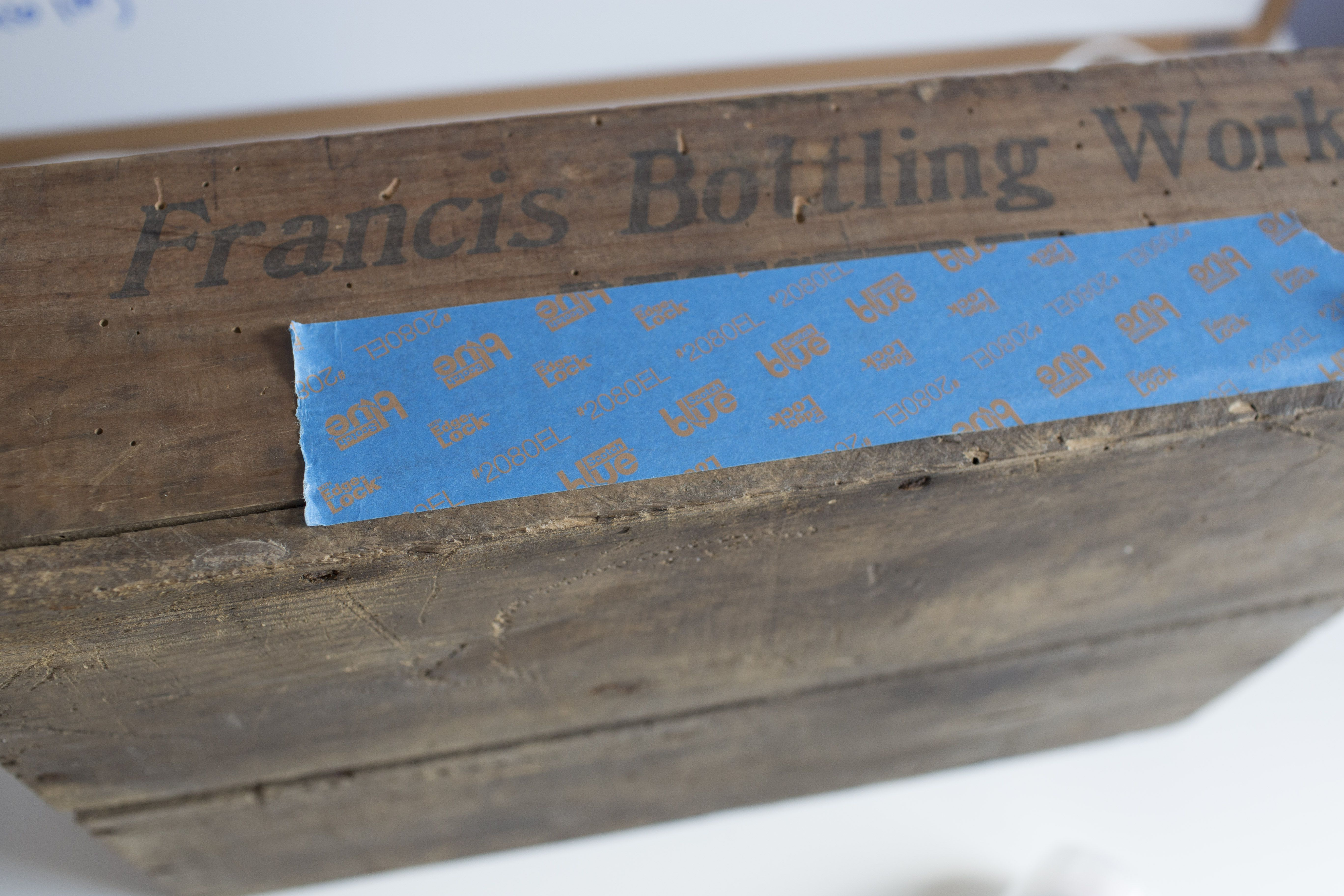 Painter's tape on a wooden crate