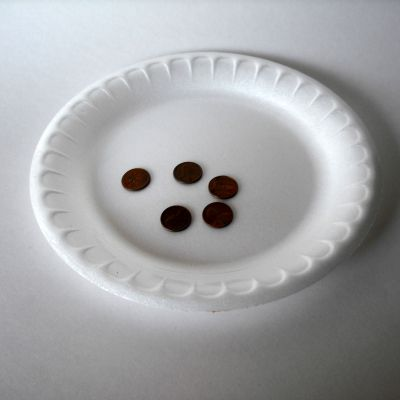 Coins on paper plate