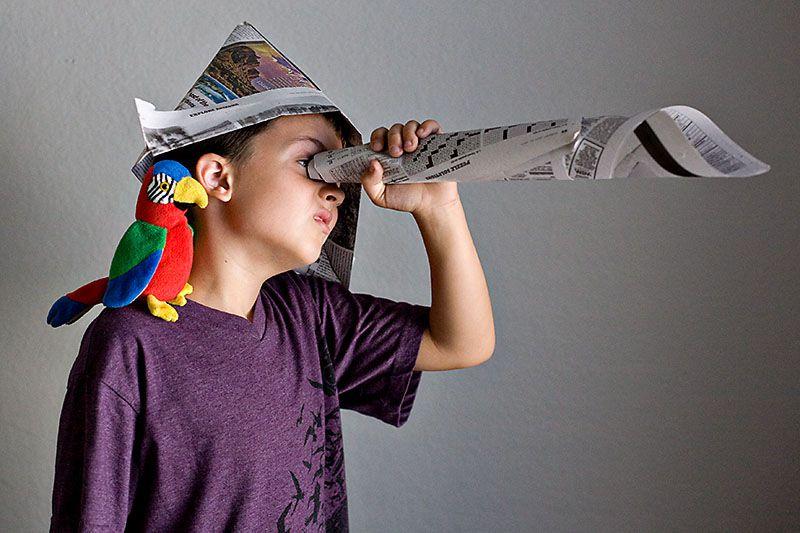 newspaper hat and spyglass