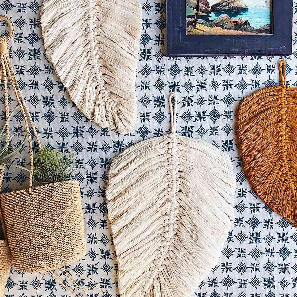 Macrame feathers hanging on a wall