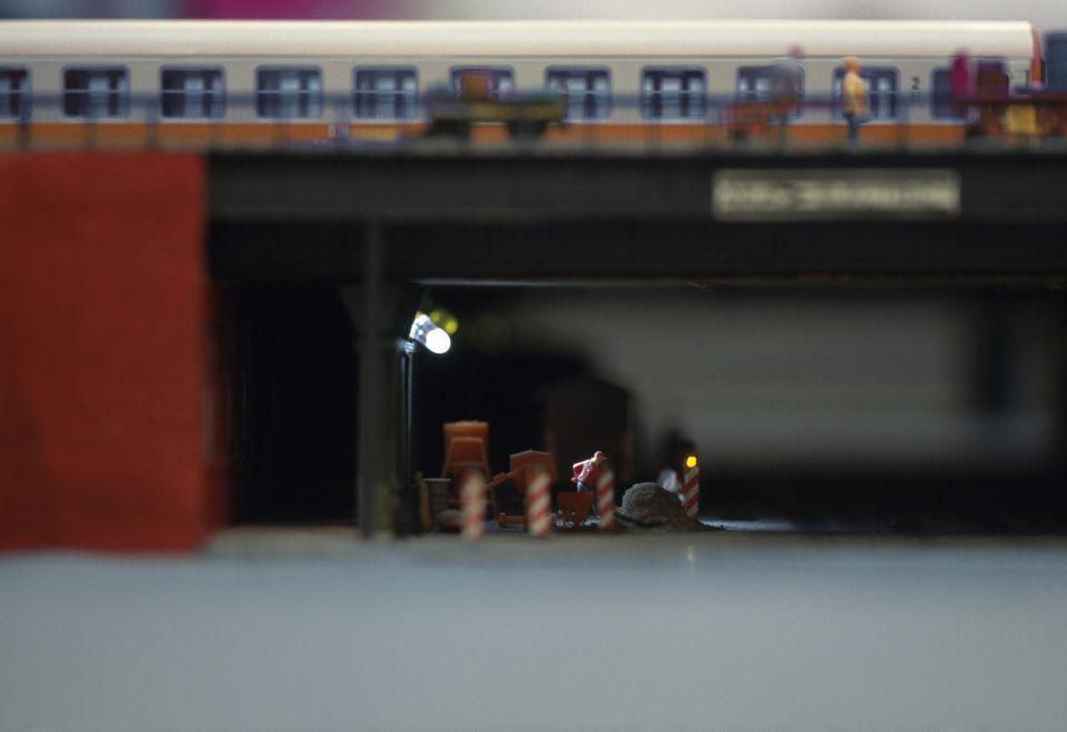Single led light spotlighting models on figure train