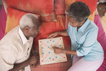 senior couple playing scrabble