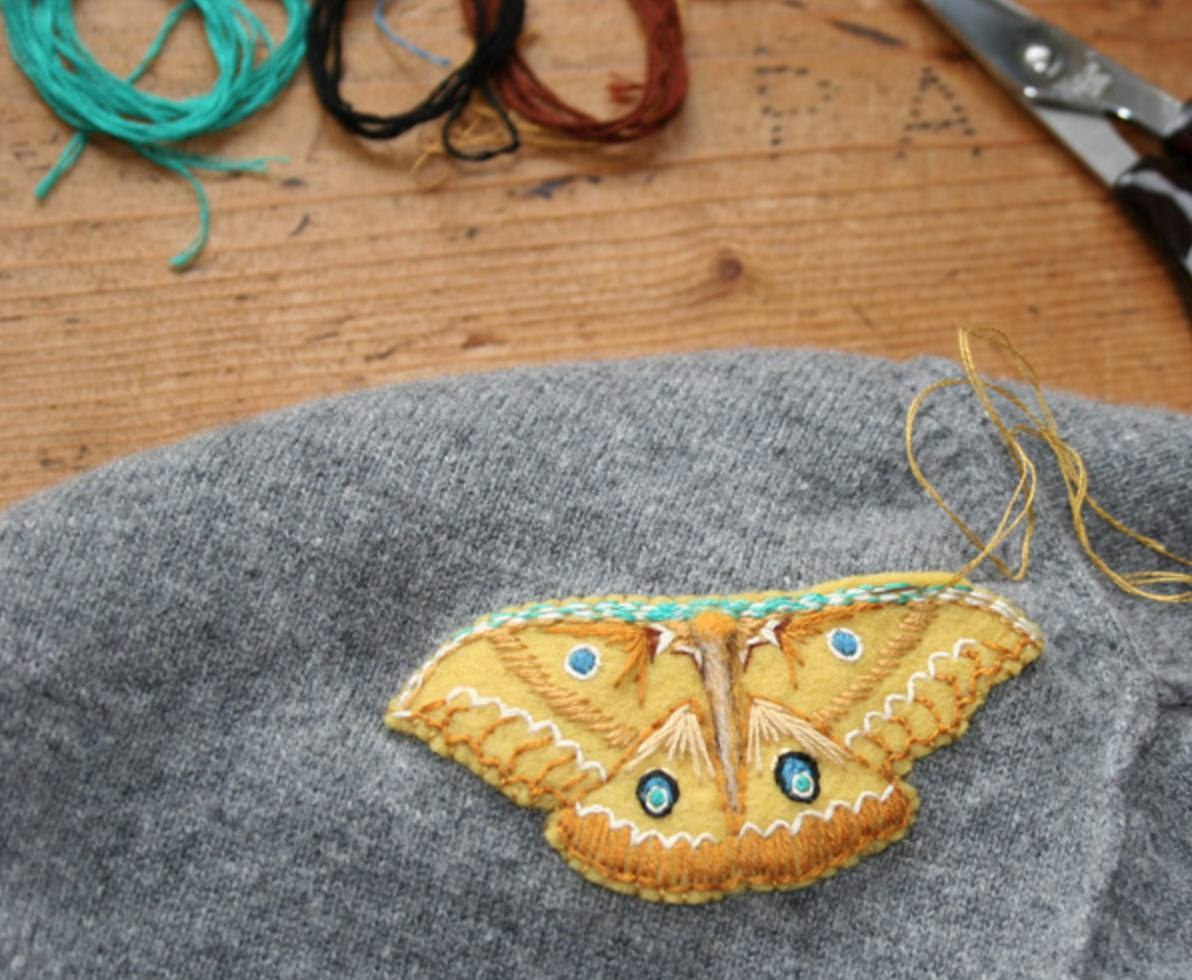 Mending moth holes with embroidered moths