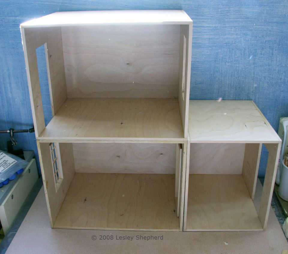 Different sized roomboxes used to make a dolls house