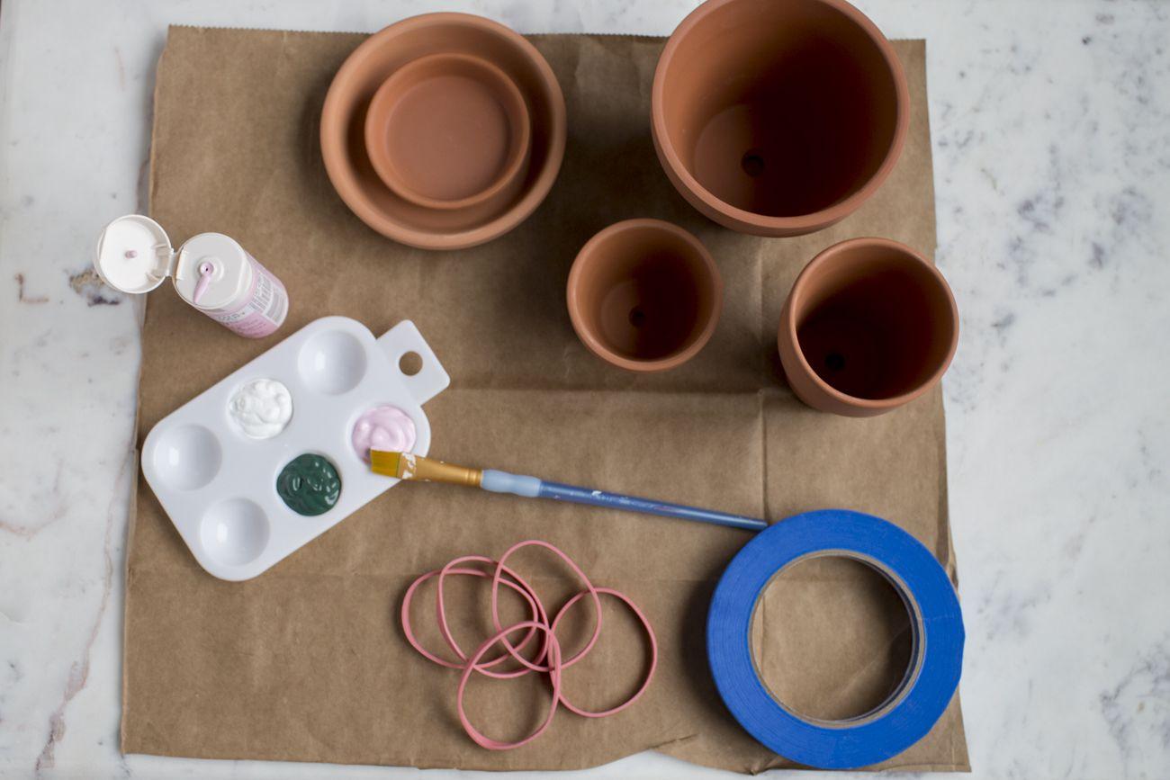 Terracotta pots and paint supplies
