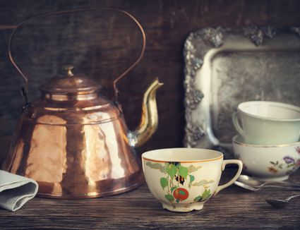 Antique tea kettle and cups