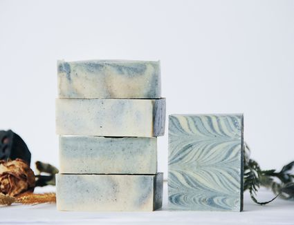 Close-Up Of Soaps Stacked Against White Background