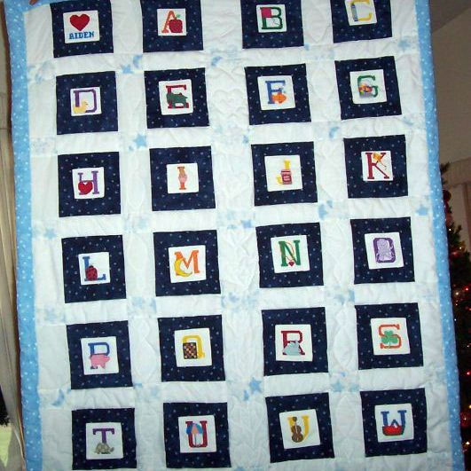 Baby quilt with alphabetical squares.