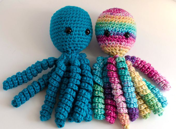 Two colorful crochet octopuses