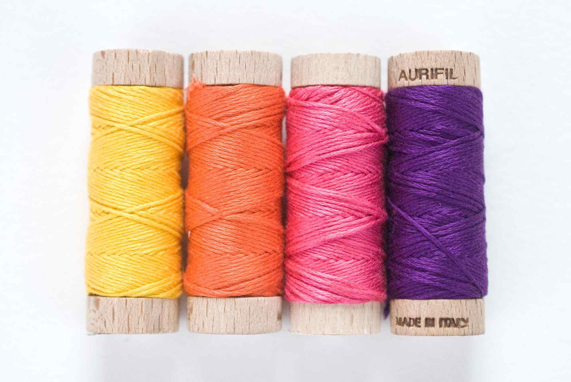 Aurifloss thread spools in a row
