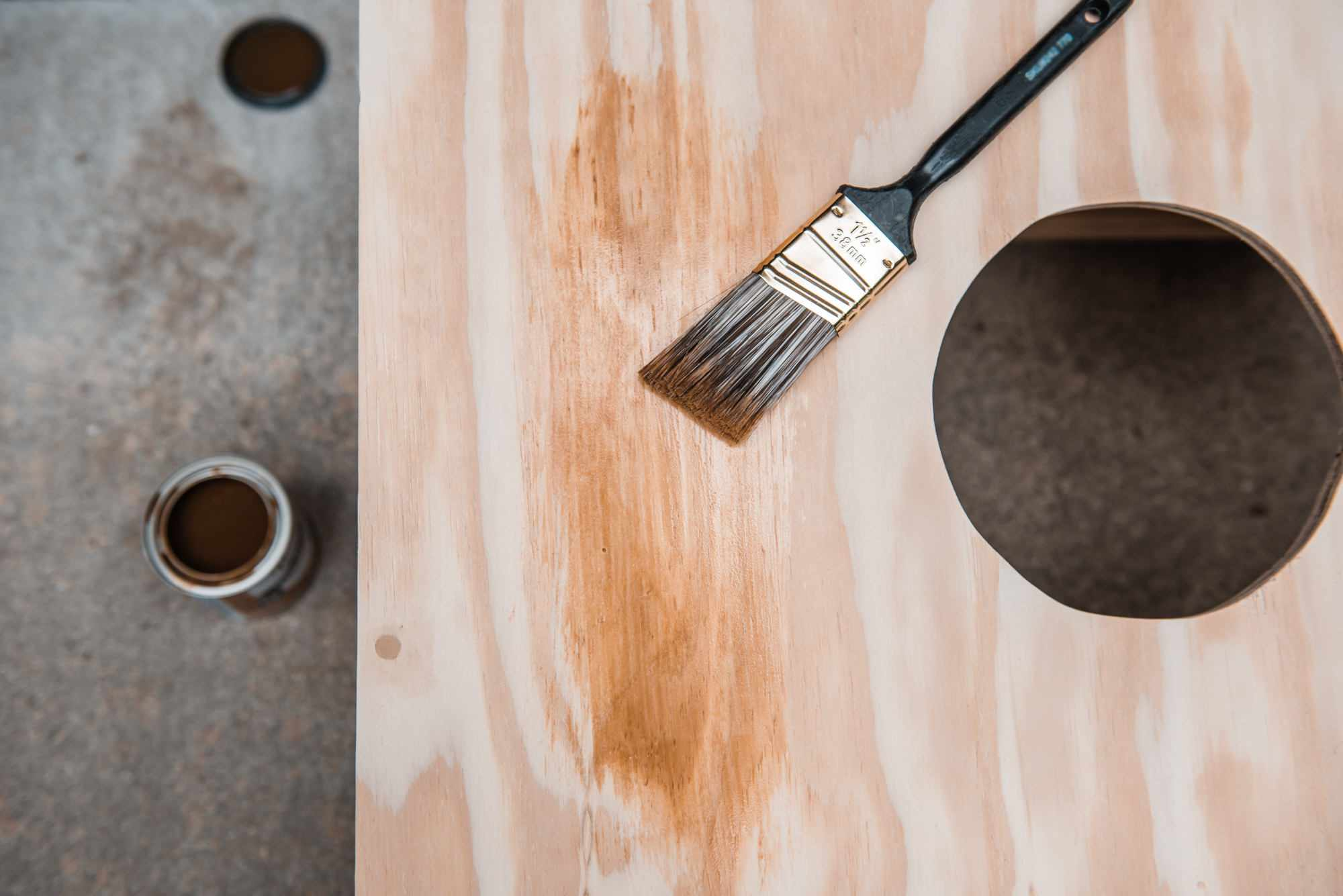 adding stain to the wood