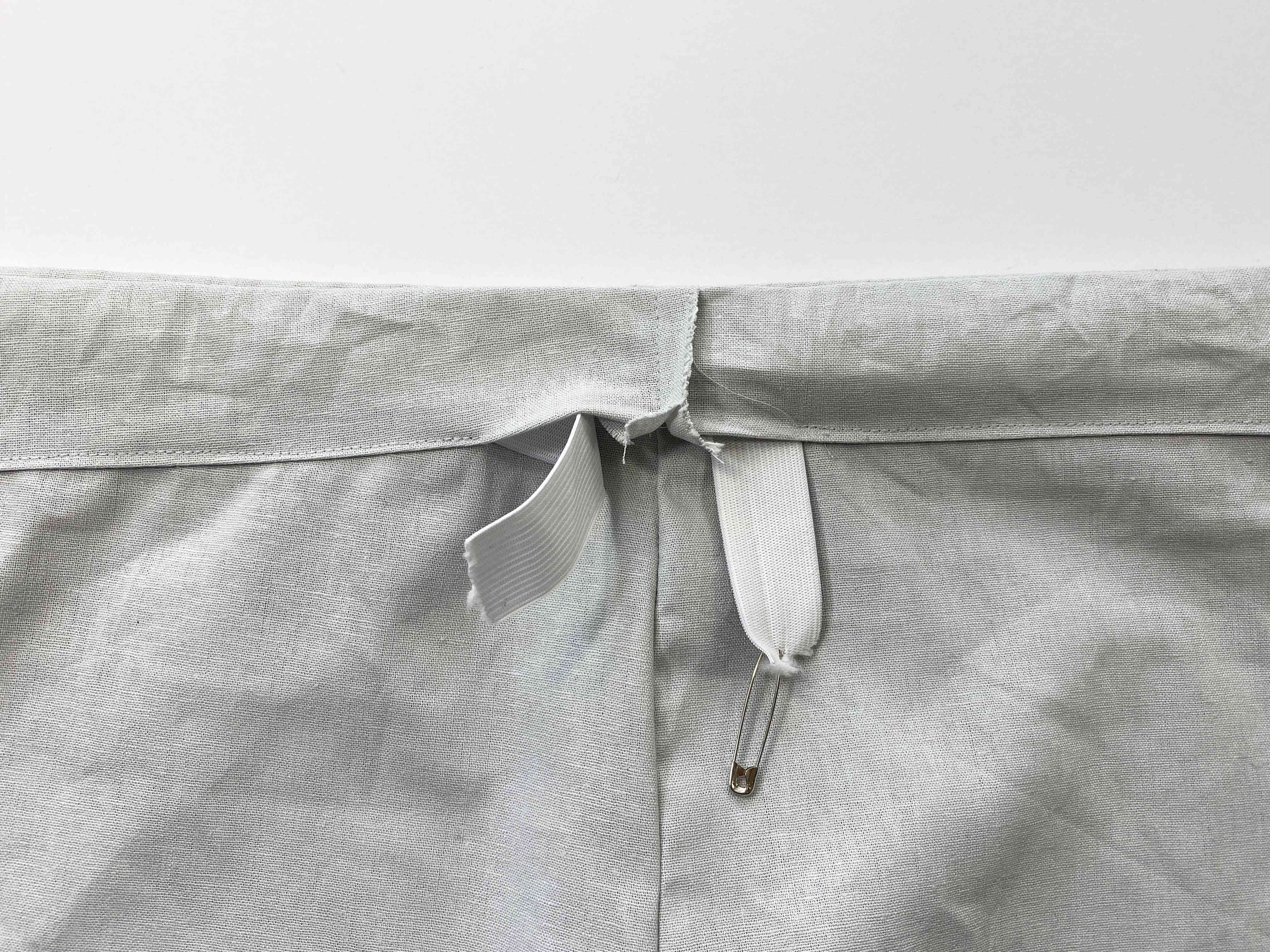 Elastic with a safety pin inserted into a waistband