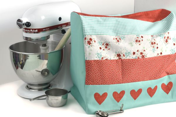 Stand mixer with a sewn DIY cover next to it