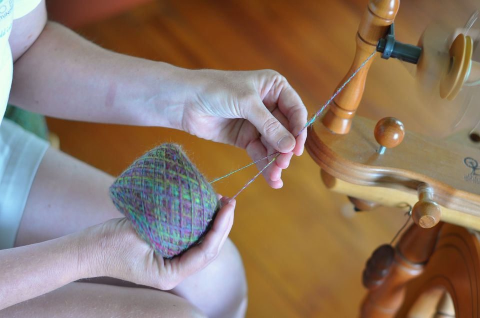 Plying wool using a spinning wheel