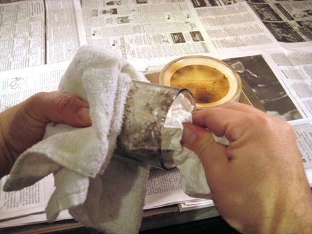 Wiping the wax and soot out of the container