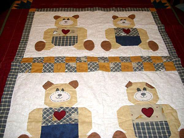 Baby bear quilt with four bears.