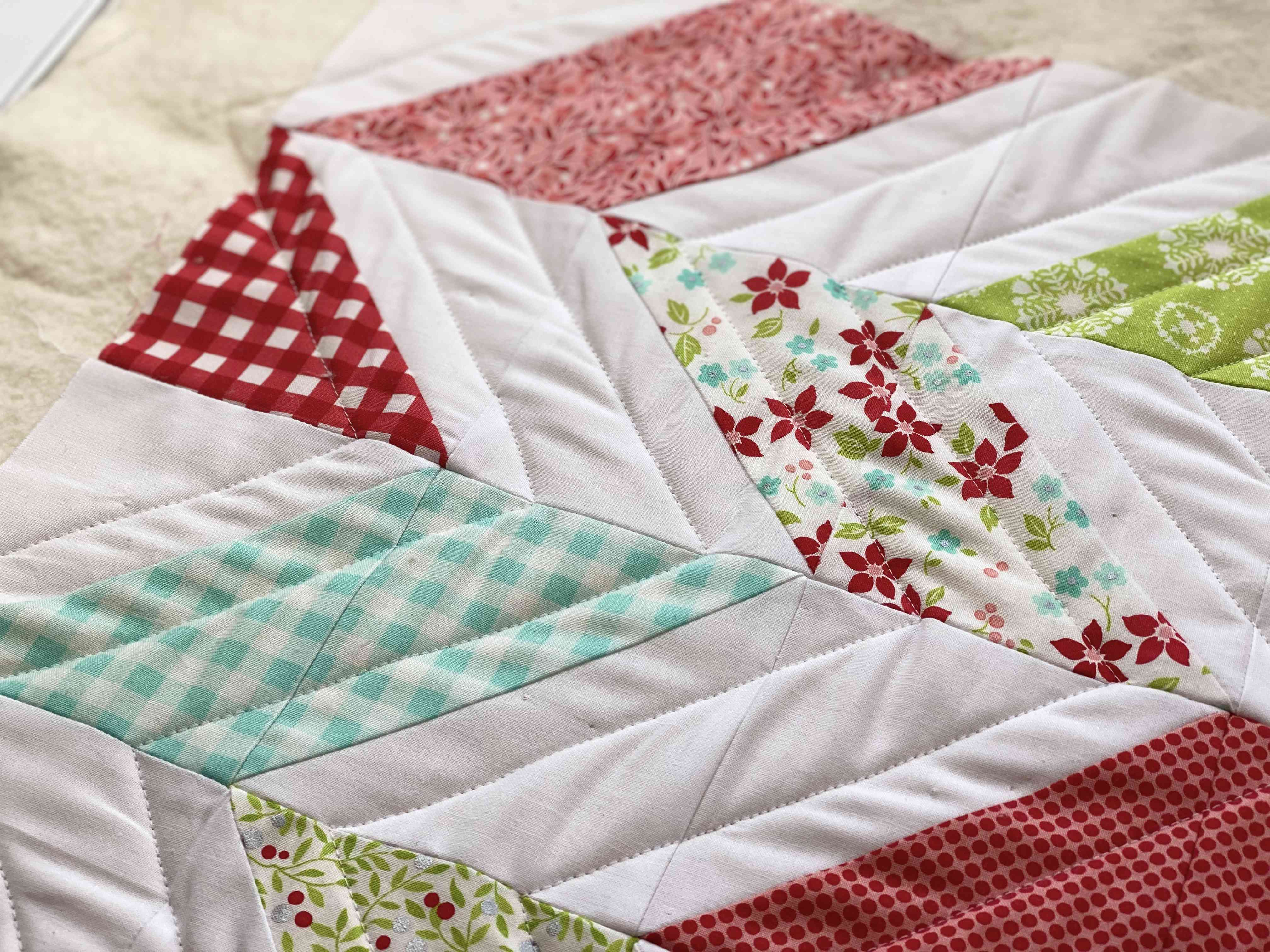 Outlining the herringbone pattern with quilting