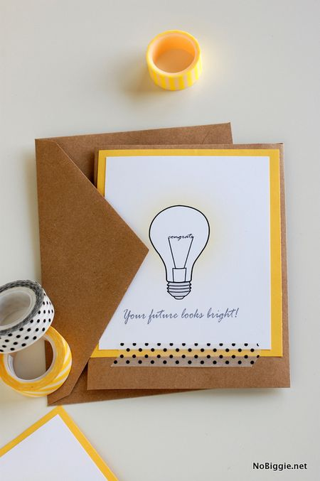 A Yellow And White Graduation Card On Table