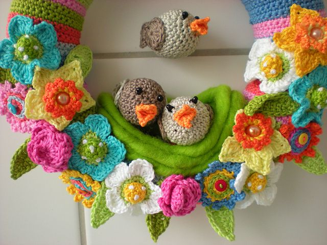 Colorful flowers and adorable crochet birds embody spring