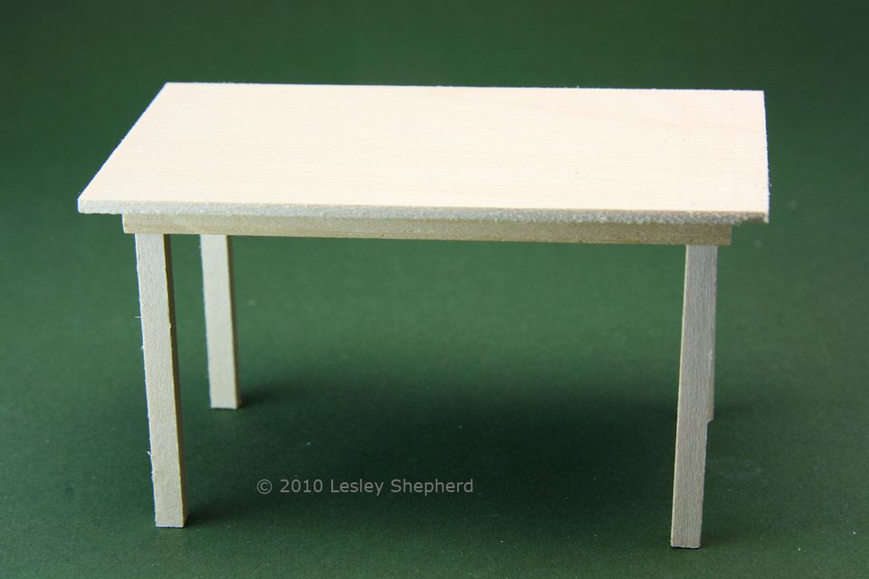 A simple kitchen table in dolls house scale ready for final sanding and finishing.