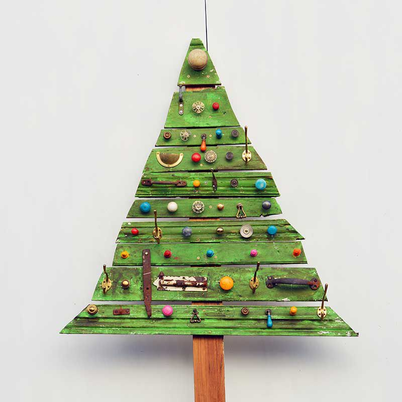 Upcycled Christmas Tree made from odds and ends and slabs of wood painted green.