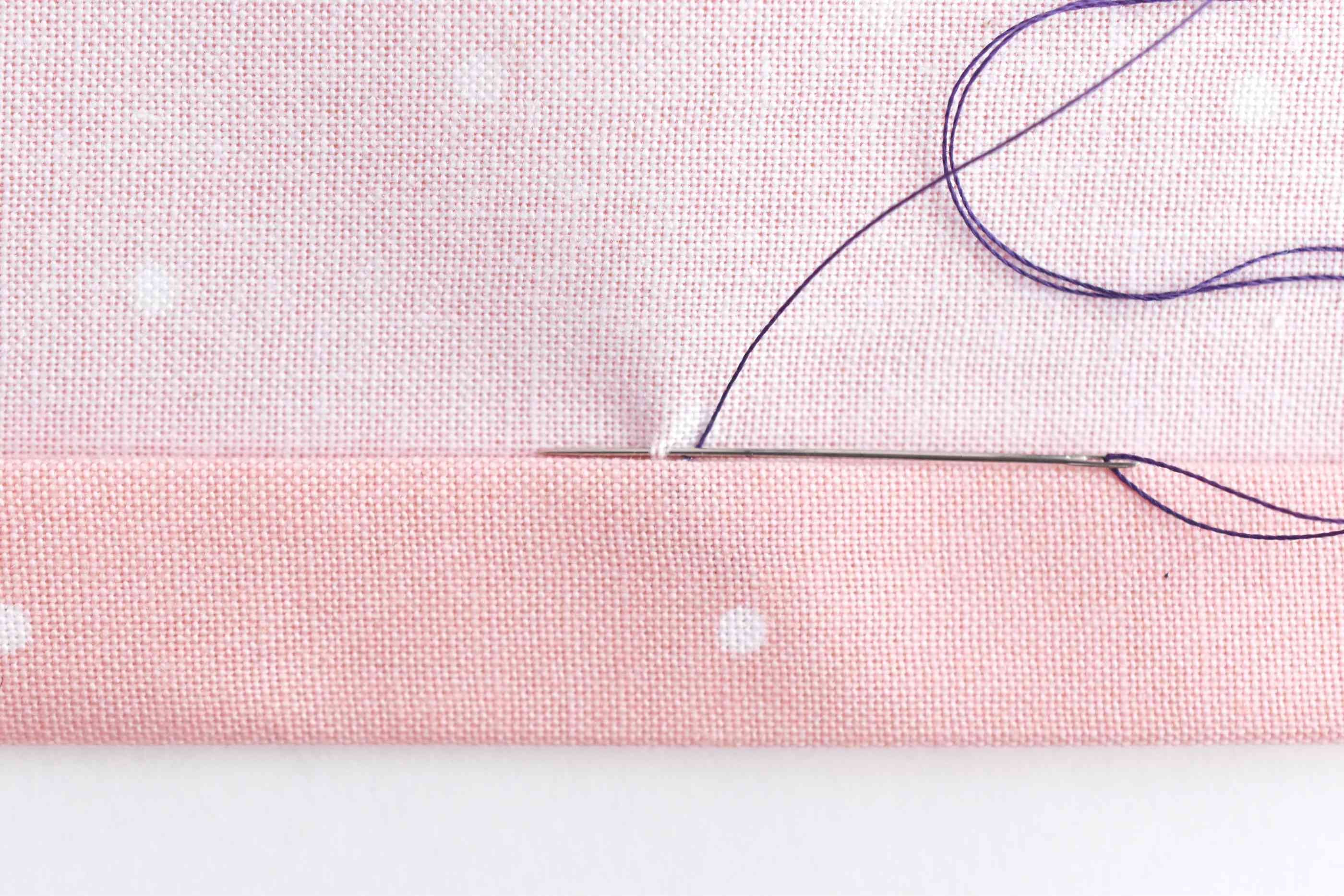Take a Tiny Stitch Through the Front of the Fabric