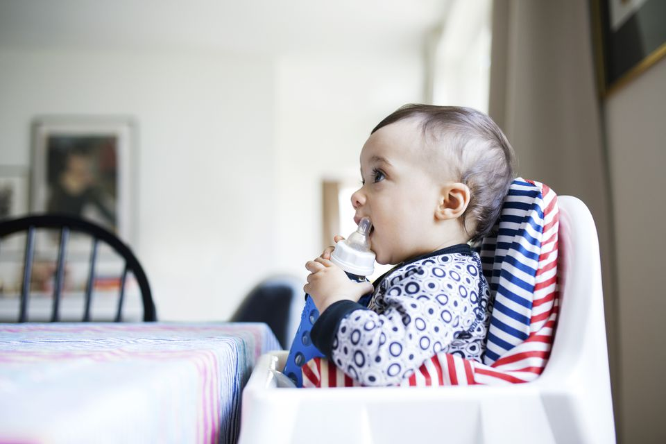Baby in high chair that has a cushion